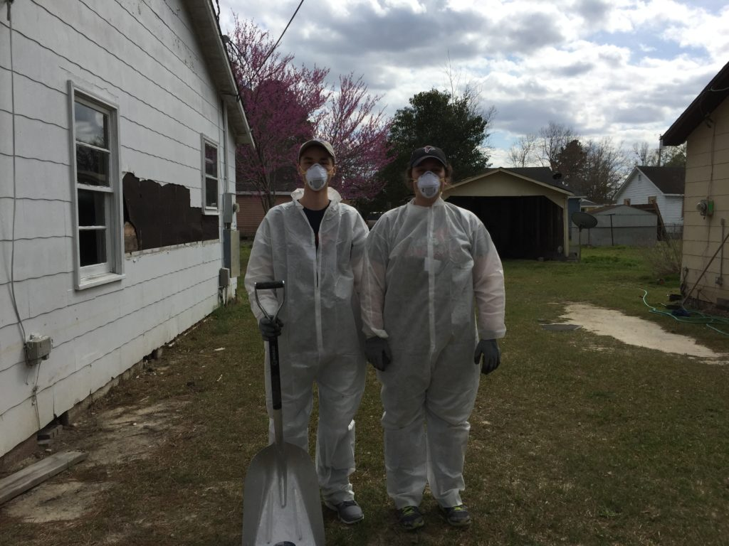 Two of our student members dressed up to gut out a home.